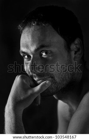 portrait of a man in black and white - stock photo
