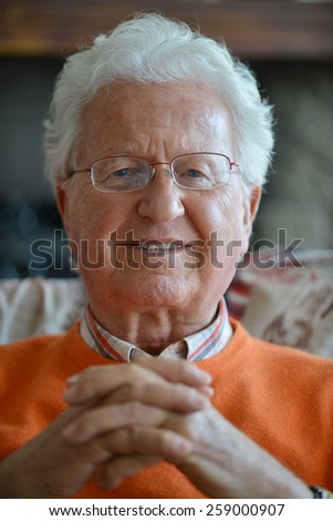 Portrait of a man in his house - stock photo
