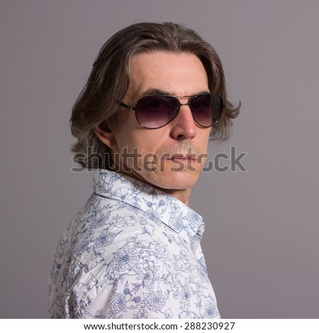 Portrait of a man in sunglasses. - stock photo