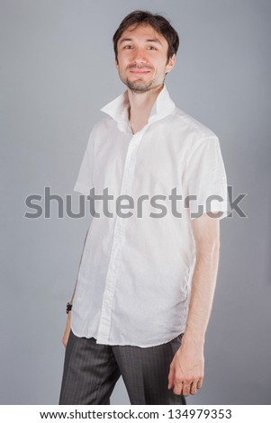 Portrait of a man in the studio - stock photo