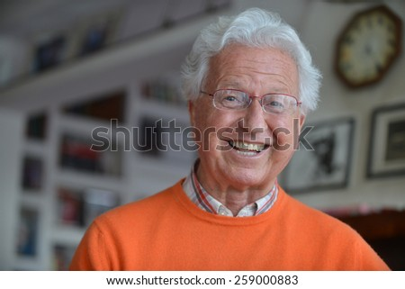 Portrait of a man laughing in his house - stock photo