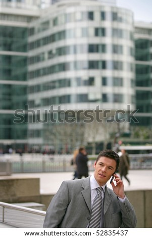Portrait of a man phoning in front of a building - stock photo