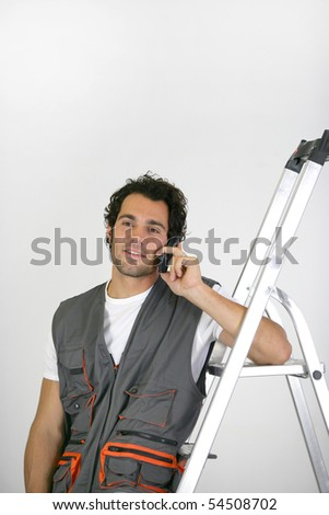 Portrait of a man phoning next to a scale - stock photo