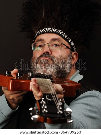 portrait of a man playing the electric guitar - stock photo