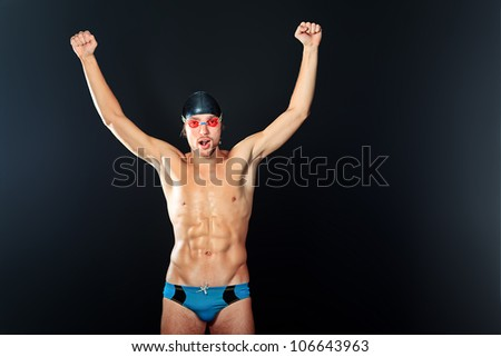 Portrait of a man professional  swimmer, champion enjoying his victory. - stock photo