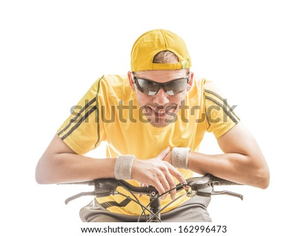portrait of a man riding a bicycle in yellow shirt sunglasses and cap isolated against white background  - stock photo