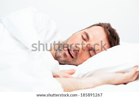Portrait of a man sleeping with an open mouth - stock photo