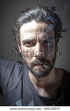 Portrait of a man smoking - stock photo