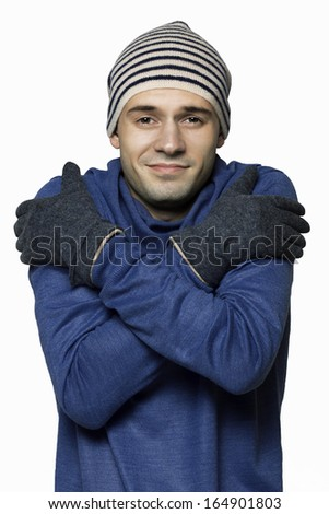 Portrait of a man trying to keep warm in isolation on a white background - stock photo