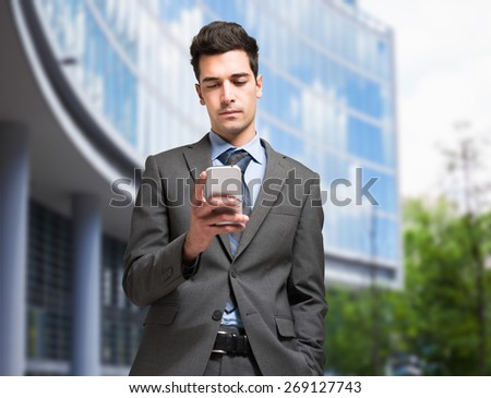 Portrait of a man using his mobile phone - stock photo