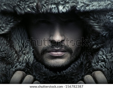 Portrait of a man wearing hood - stock photo