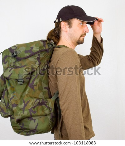 portrait of a man with backpack - stock photo