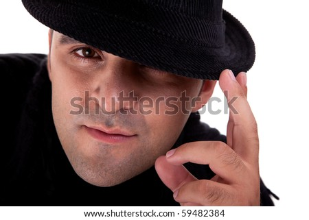 Portrait of a man with his black hat, isolated on white. Studio shot - stock photo