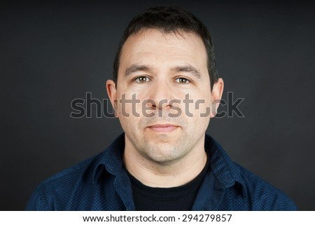 Portrait of a man with neutral facial expression - stock photo