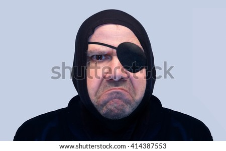 Portrait of a man with the eye patch. Brutal face criminals. Angry face of a man with a pirate eyepatch. Portrait grinning criminals. Unshaven face an bad man with eye tape. - stock photo