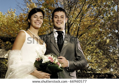 Portrait of a married couple outside the church - stock photo