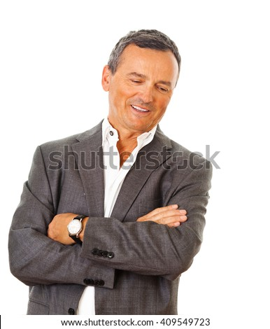 Portrait of a mature business man, wearing a grey suit, standing with arms crossed. - stock photo