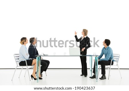 Portrait Of A Mature Businesswoman Giving Presentation - stock photo
