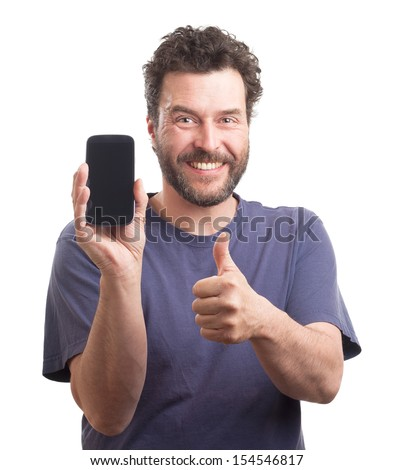 Portrait of a mature Caucasian man with beard and blue shirt, showing a smart phone into the camera. - stock photo