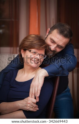 portrait of a mature couple, they are happy, smiling to each other - stock photo