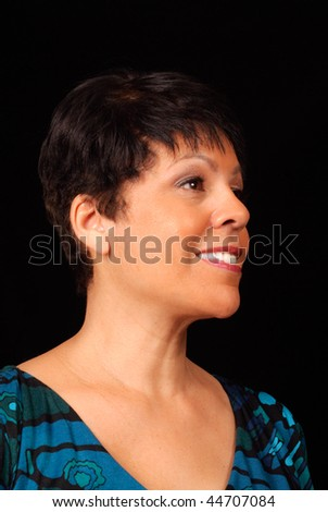 portrait of a mature lady against black background - stock photo