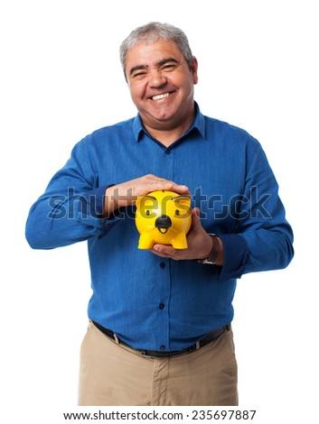 portrait of a mature man holding a piggy bank - stock photo