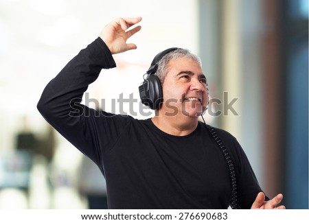 portrait of a mature man listening to music - stock photo