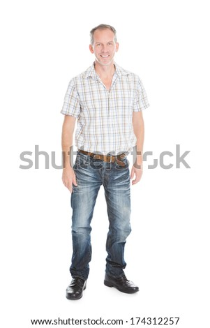 Portrait Of A Mature Man Standing Over White Background - stock photo