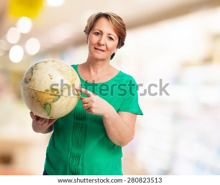portrait of a mature woman holding a earth globe - stock photo