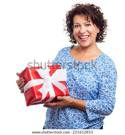 portrait of a mature woman holding a gift on a white background - stock photo