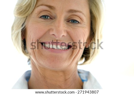 Portrait of a mature woman over white background - stock photo