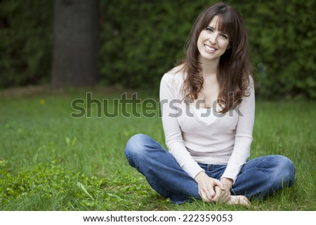 Portrait Of A Mature Woman Smiling - stock photo