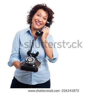 portrait of a mature woman talking on a telephone - stock photo