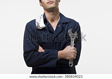 Portrait of a mechanic - stock photo