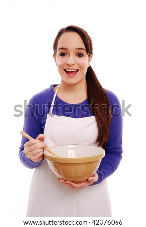 Portrait of a messy chef with mixing bowl on white background - stock photo