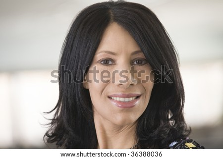 Portrait of a mid adult woman smiling - stock photo