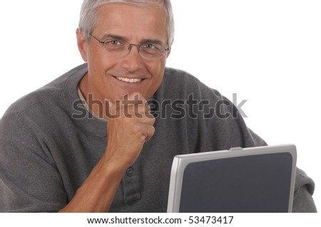 Portrait of a middle aged caucasian man looking over his laptop computer. Man is wearing casual attire and smiling with his hand on his chin. Close crop in horizontal format isolated  white. - stock photo