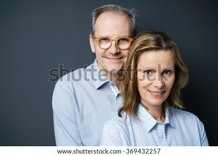 portrait of a middle-aged couple standing close together - stock photo