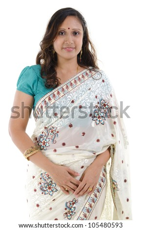 Portrait of a middle aged Traditional Indian woman in sari costume isolated on white background - stock photo