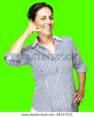 portrait of a middle aged woman talking gesture against a removable chroma key background - stock photo