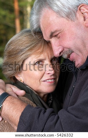 Portrait of a middleaged couple hugging each other - stock photo