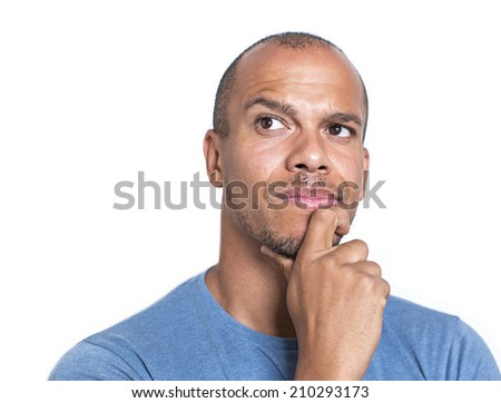 Portrait of a mixed race man concentrating and thinking about something with his hand on his chin - stock photo