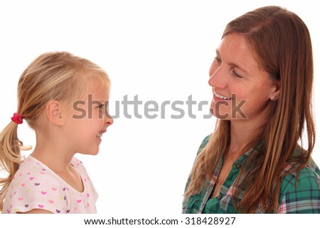 Portrait of a mother and daughter on white background - stock photo