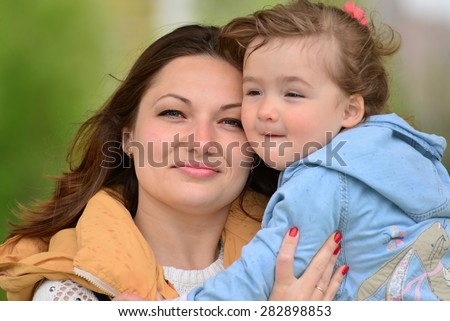 Portrait of a mother with her daughter 2.5 years for a walk - stock photo
