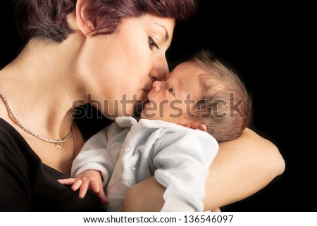 Portrait of a mother with her newborn baby - stock photo