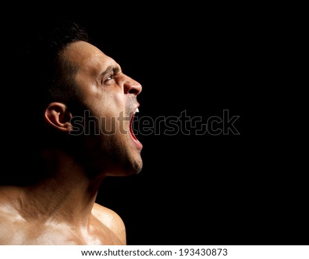 Portrait of a muscular man screaming - stock photo