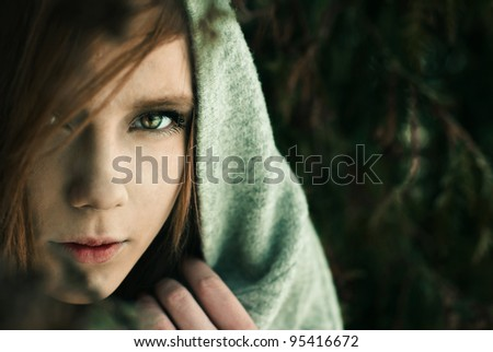 portrait of a mysterious young woman - stock photo