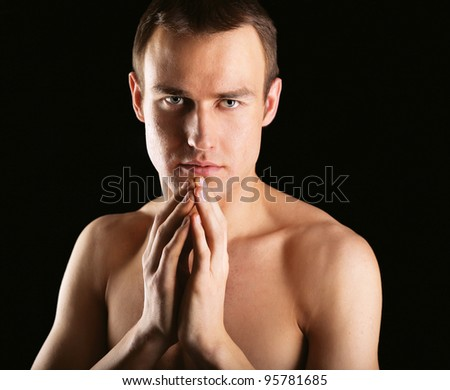 Portrait of a naked muscular man - stock photo