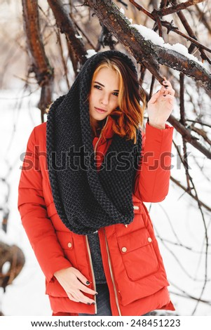 Portrait of a natural, young and beautiful  woman in a winter park.  - stock photo