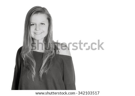 Portrait of a natural young woman, isolated in front of white studio background, monochrome photo with copy space on the right side of the image - stock photo